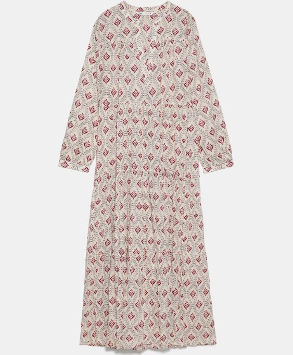 Εμπριμέ φόρεμα με όγκο Zara39,95 EUR